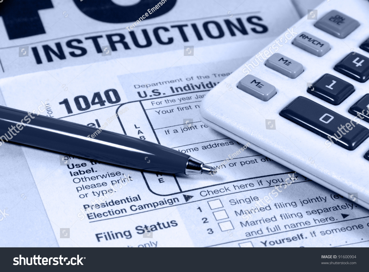 United States Income Tax Form And Instruction Sheet Calculator And Pen Stock Photo