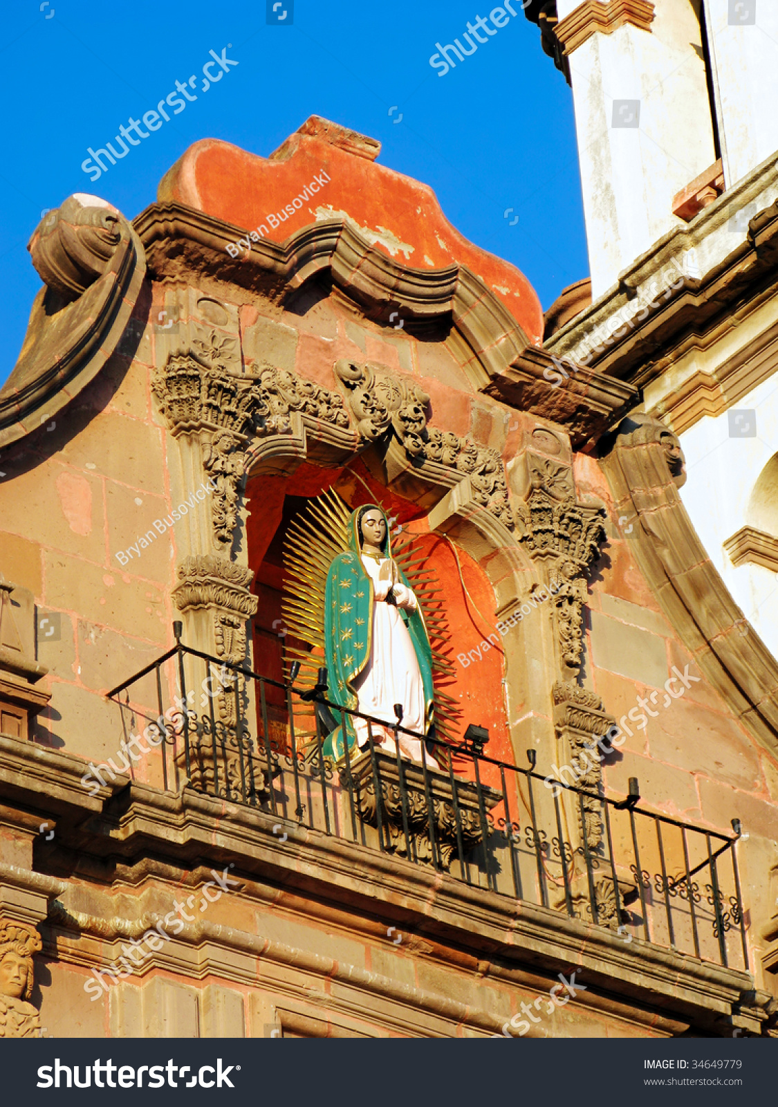 Virgin Guadalupe Statue On Facade Temple Stock Photo