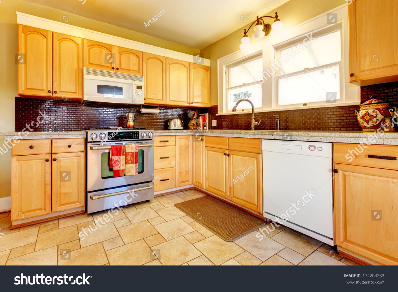 https www shutterstock com image photo yellow kitchen wood cabinets dark brown 174204233