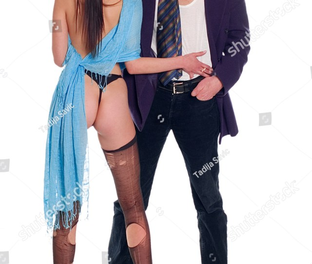 Young Naked Woman With Ripped Stocking And Man With Tie On Undershirt