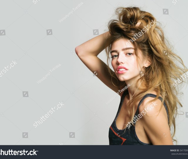 Young Pretty Woman Or Cute Sexy Girl With Long Hair In Fashionable Vest Poses On