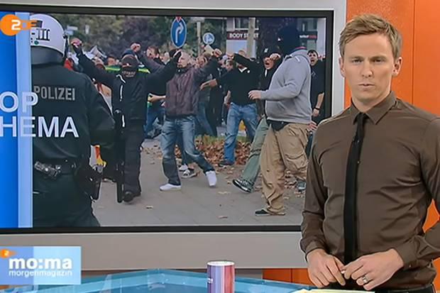 Steht das braune Hemd für eine braune Gesinnung? Eine absurde Frage - und doch haben sich Zuschauer beim ZDF über die Kleidung von Moderator Jochen Breyer beschwert.