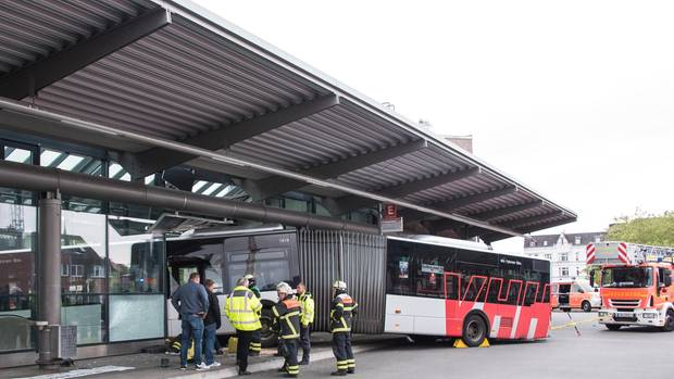 Fire fighters secure an articulated bus