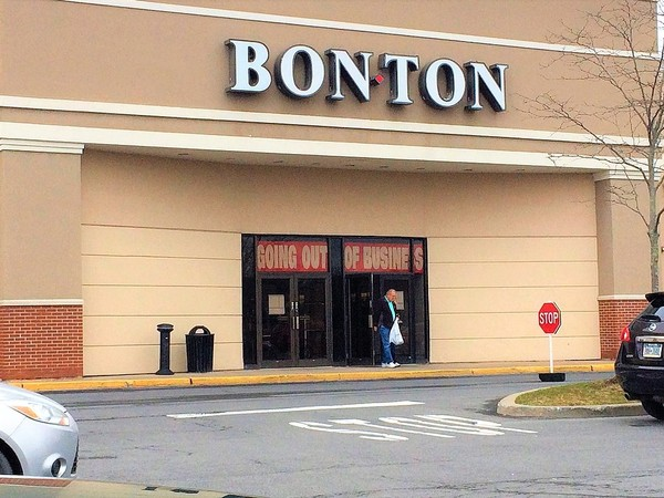 a customers walks out of the bon ton store in camillus on friday