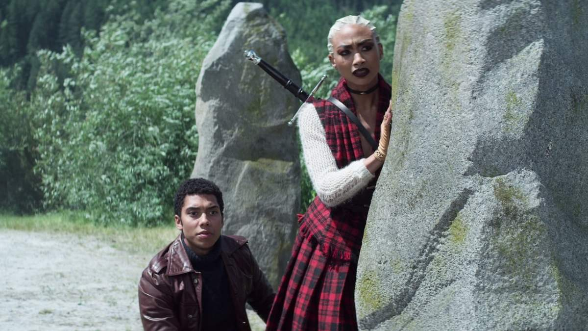 Couple hiding behind rock with swords fantasy Prudence and Ambrose Spellman The Chilling Adventures of Sabrina