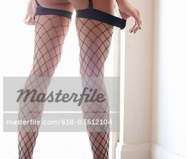 Sexy Legs And Butt With Heels And Fishnet Stocking Stock Photo