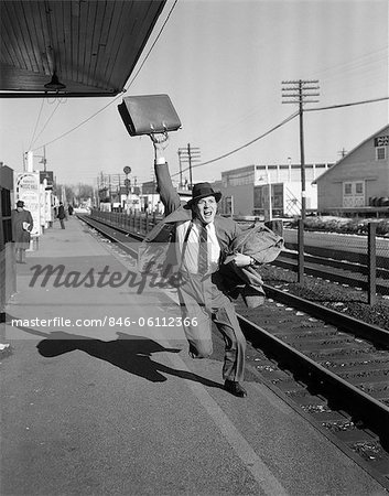 1950s BUSINESSMAN WITH BRIEFCASE IN AIR RUNNING AFTER DEPARTING TRAIN Stock Photo - Premium Rights-Managed, Artist: ClassicStock, Code: 846-06112366