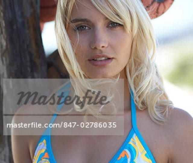 Head And Shoulders Of Blonde Girl In Bikini Stock Photo