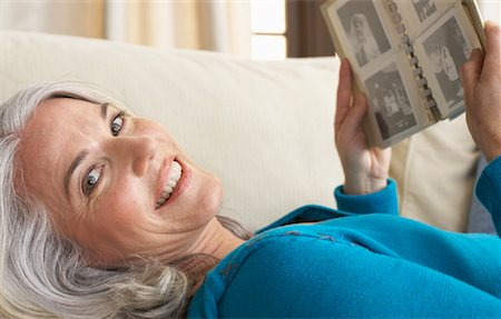 Woman Looking At Photo Album Stock Photo Premium Royalty Free Code 600