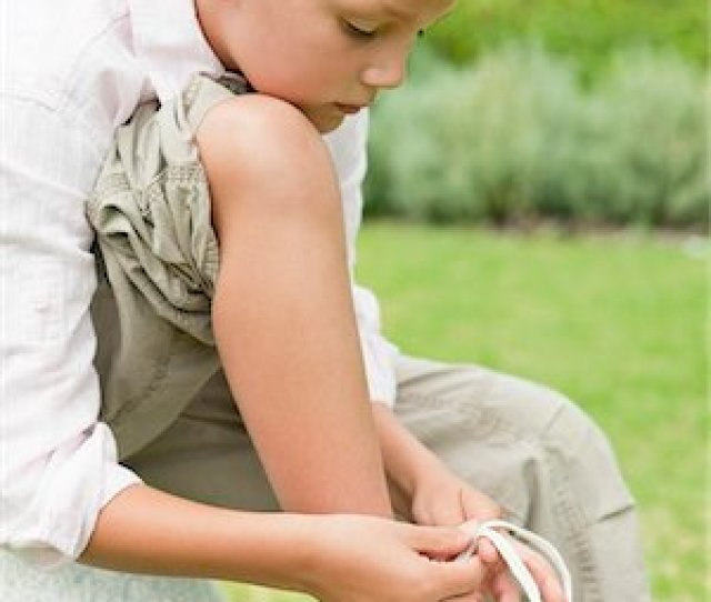 Boy Tying His Shoelaces Stock Photo Premium Royalty Free Code 6108