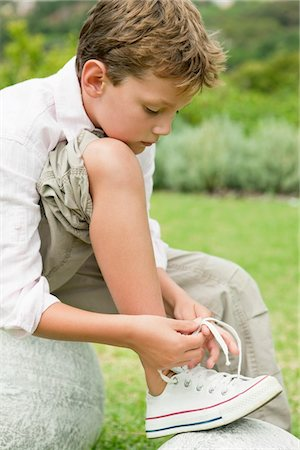 Boy Tying His Shoelaces Stock Photo Premium Royalty Free Code 6108