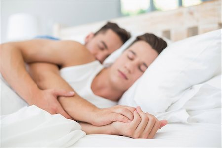 Homosexual Couple Sleeping On Bed Stock Photo Premium Royalty Free Code 6109