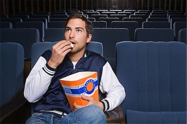 Image result for man enjoying alone in a cinema