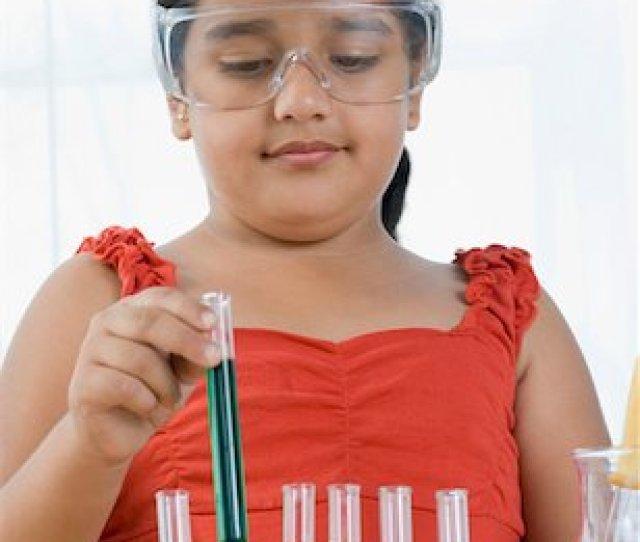 East Indian Medical Student Close Up Of A Girl Picking A Test Tube From