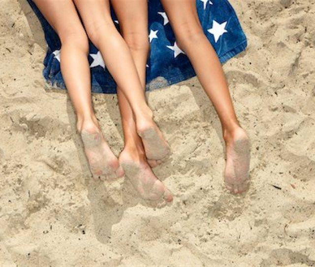Pre Teens Legs Girls Lying At The Beach Stock Photo Premium Royalty Free