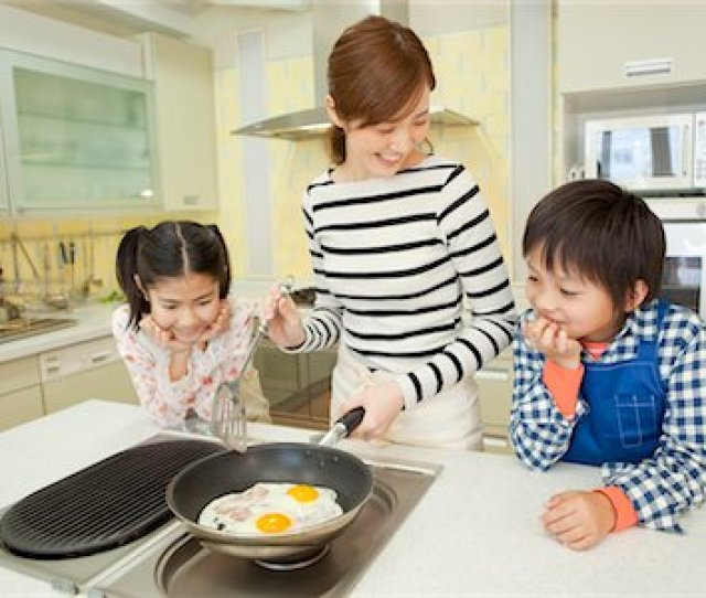 Mother And Children Cooking Stock Photo Premium Royalty Free Code