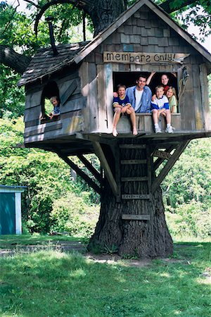 Little boy in treehouse Stock Photos - Page 1 : Masterfile