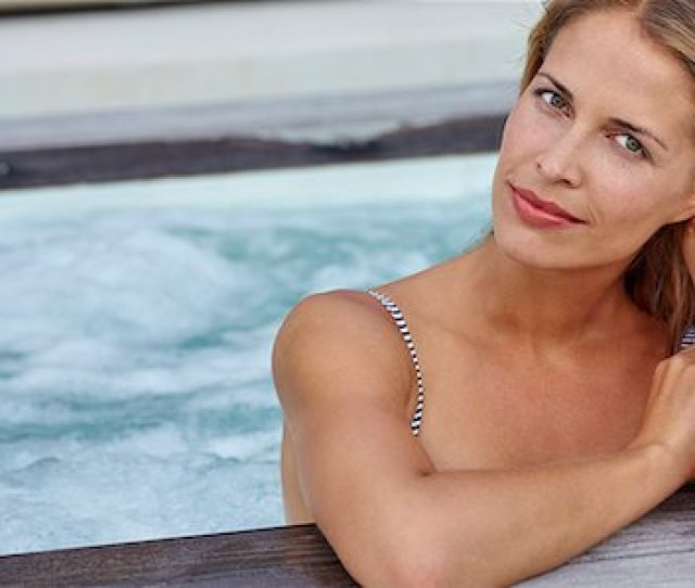 Swimwear Mature Woman Jacuzzi Beautiful Woman In Hot Tub Wearing Striped Bikini Stock Photo