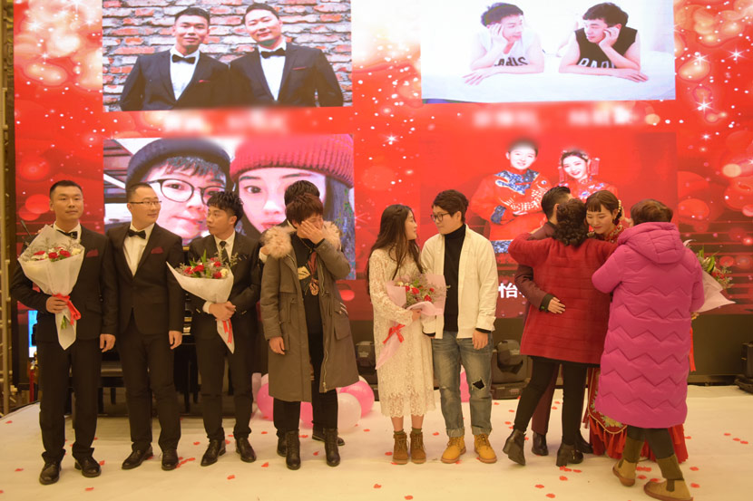 Participants in a group wedding ceremony for same-sex couples stand onstage in Wuhan, Hubei province, Jan. 4, 2020. Courtesy of PFLAG
