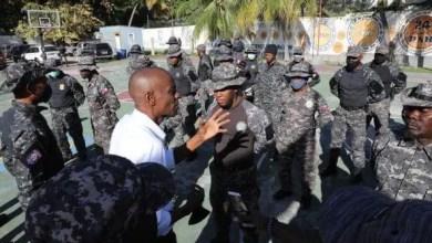 Fantômes 509vsSwat:JovenelMoïse avisitélabasede l'unitéSwatTeam endeuillée - fantômes 509, oposition, PNH, Spnh