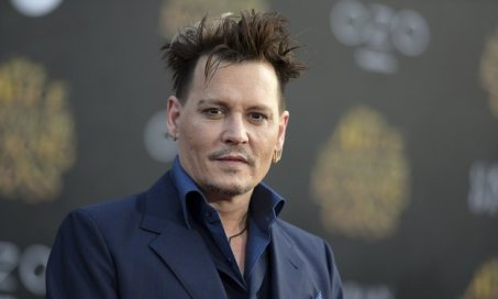 Johnny Depp plays villain Grindelwald, one of Fantastic Beasts' biggest surprises. Image Amplified www.imageamplified.com