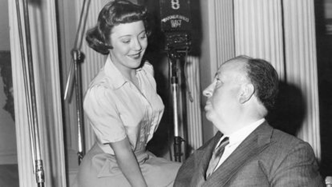 Patricia Hitchcock, with her father on the set of 'Strangers on a train'.