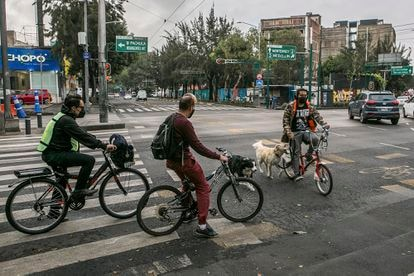 People ride bicycles in the Roma Norte neighborhood of Mexico City.