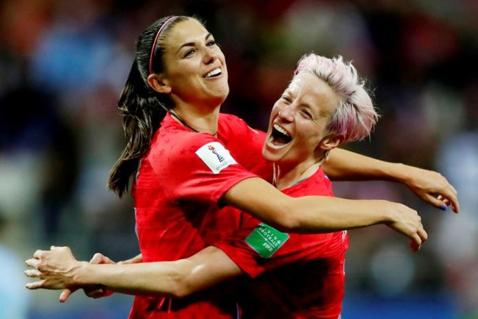 Alex Morgan (left) and Megan Rapinoe celebrate a goal in the World cup of 2019.