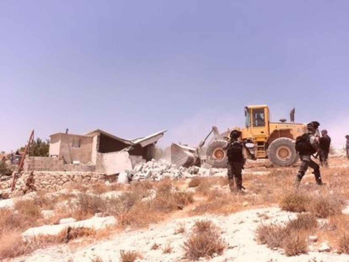 The Israeli Army with a machine in the demolition of a Palestinian house in Jalet al Dabaa (West Bank), in the area of the southern hills of Hebron.