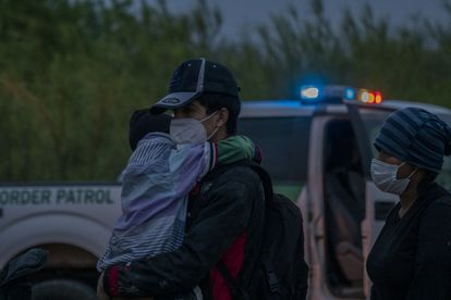 Migrants surrender to elements of the border patrol seeking humanitarian asylum in La Joya, Texas, on April 1, 2021.