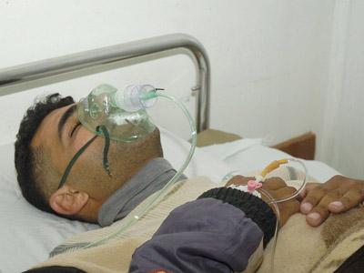 Un herido después de las últimas protestas sirias.