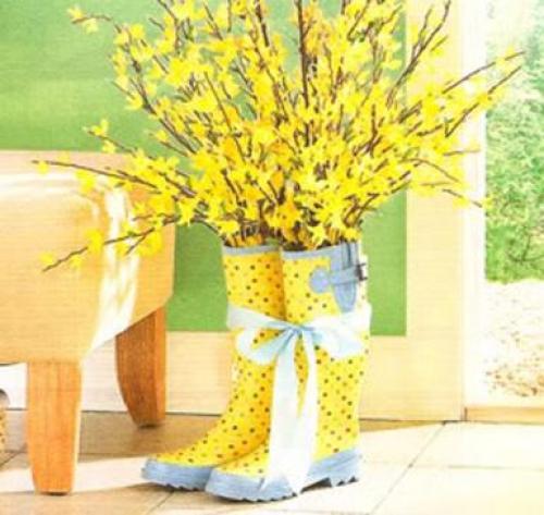 Botas usadas como macetas de flores