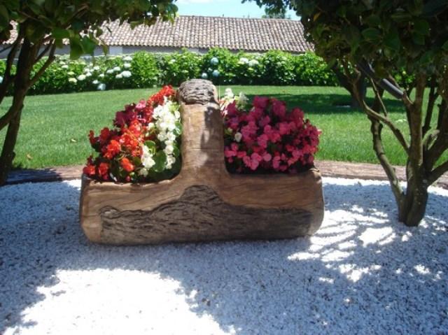 Fotos de jardines con troncos reciclados