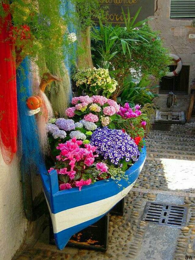 Imagenes con ideas para decorar el jardín con flores
