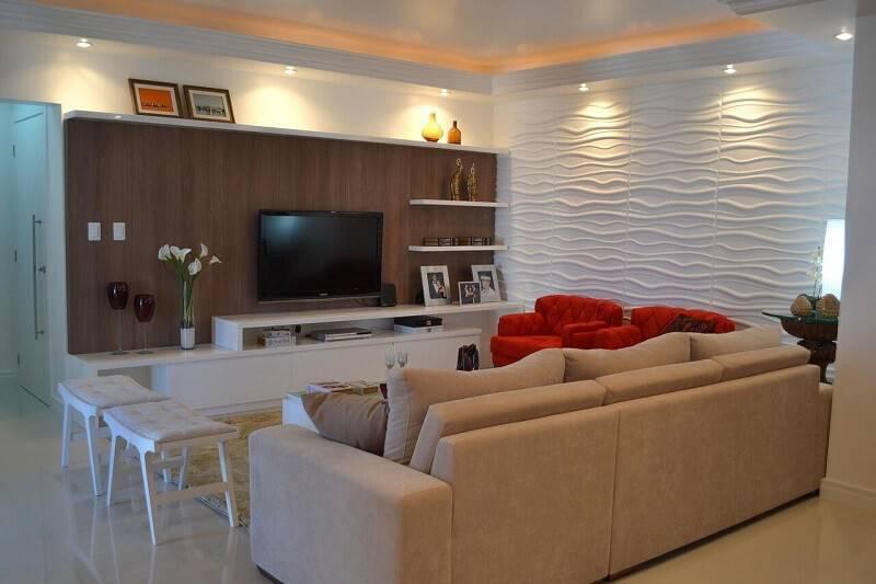 sala planejada com painel de tv de madeira projeto de ELO Arquitetura Engenharia