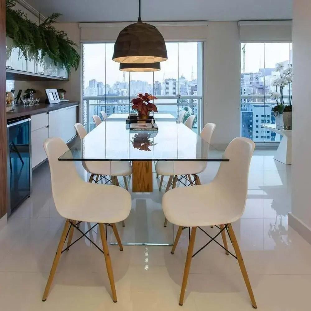 decoração clean com mesa de vidro para área gourmet moderna