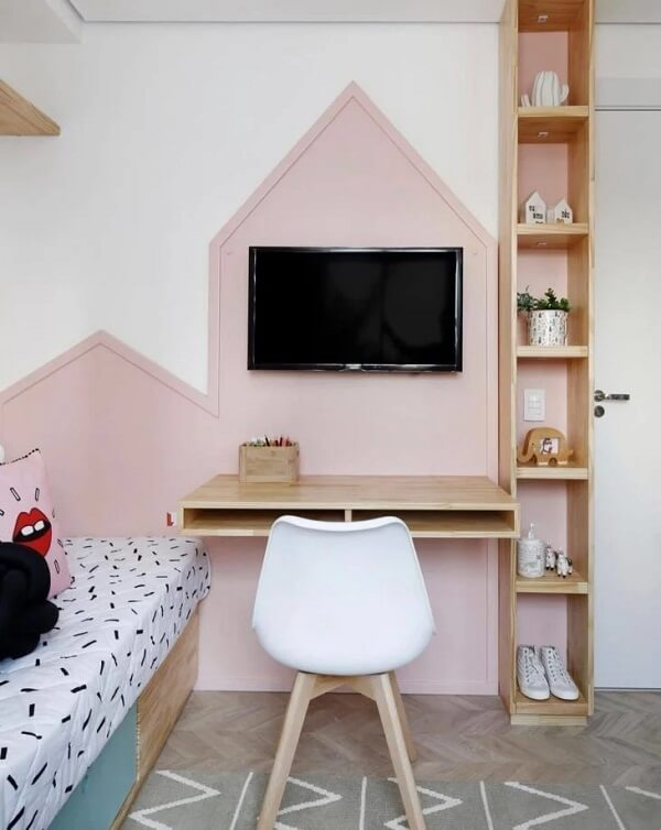 The various compartments of the wooden niche help to organize various items in the room