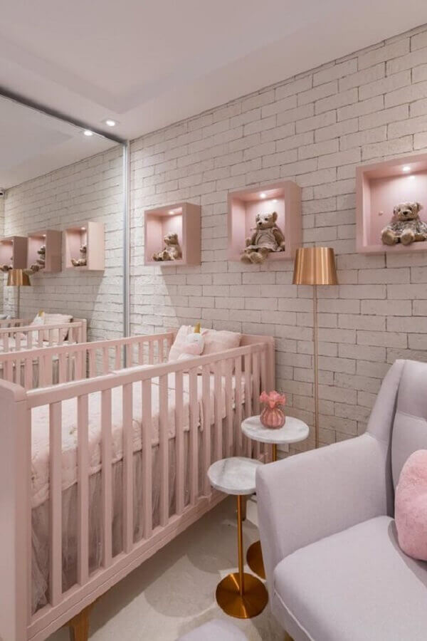 white and pink feminine baby room decor with brick wall Photo Pinterest