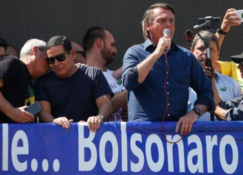 Bolsonaro speaks alongside Vice President Hamilton Mourão.