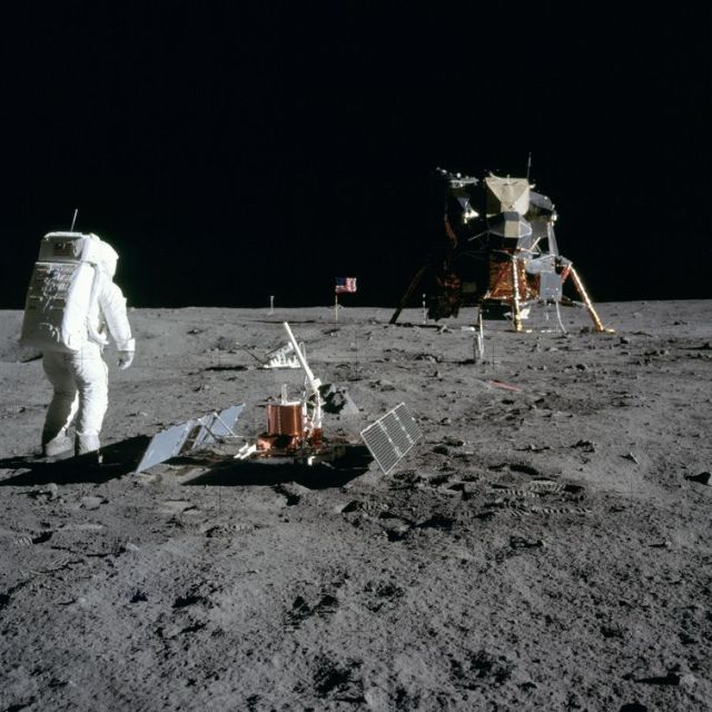 AS11-40-5948 (20 July 1969) --- Astronaut Edwin E. Aldrin Jr., lunar module pilot, is photographed during the Apollo 11 extravehicular activity (EVA) on the moon. He has just deployed the Early Apollo Scientific Experiments Package (EASEP). This