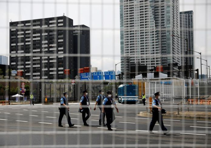 Police officers patrol at the Athletes Village ahead of Tokyo 2020 Olympic Games in Tokyo