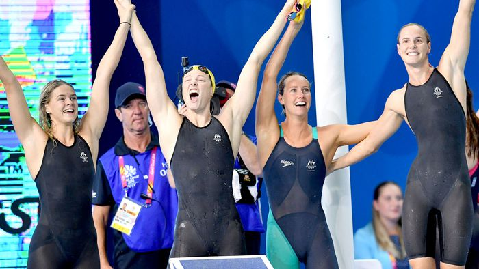 Australian swimmers Cate Campbell, sister Bronte, Shayna Jack and Emma McKeon celebrate breaking the world record in the 4x100m relay. (AAP)