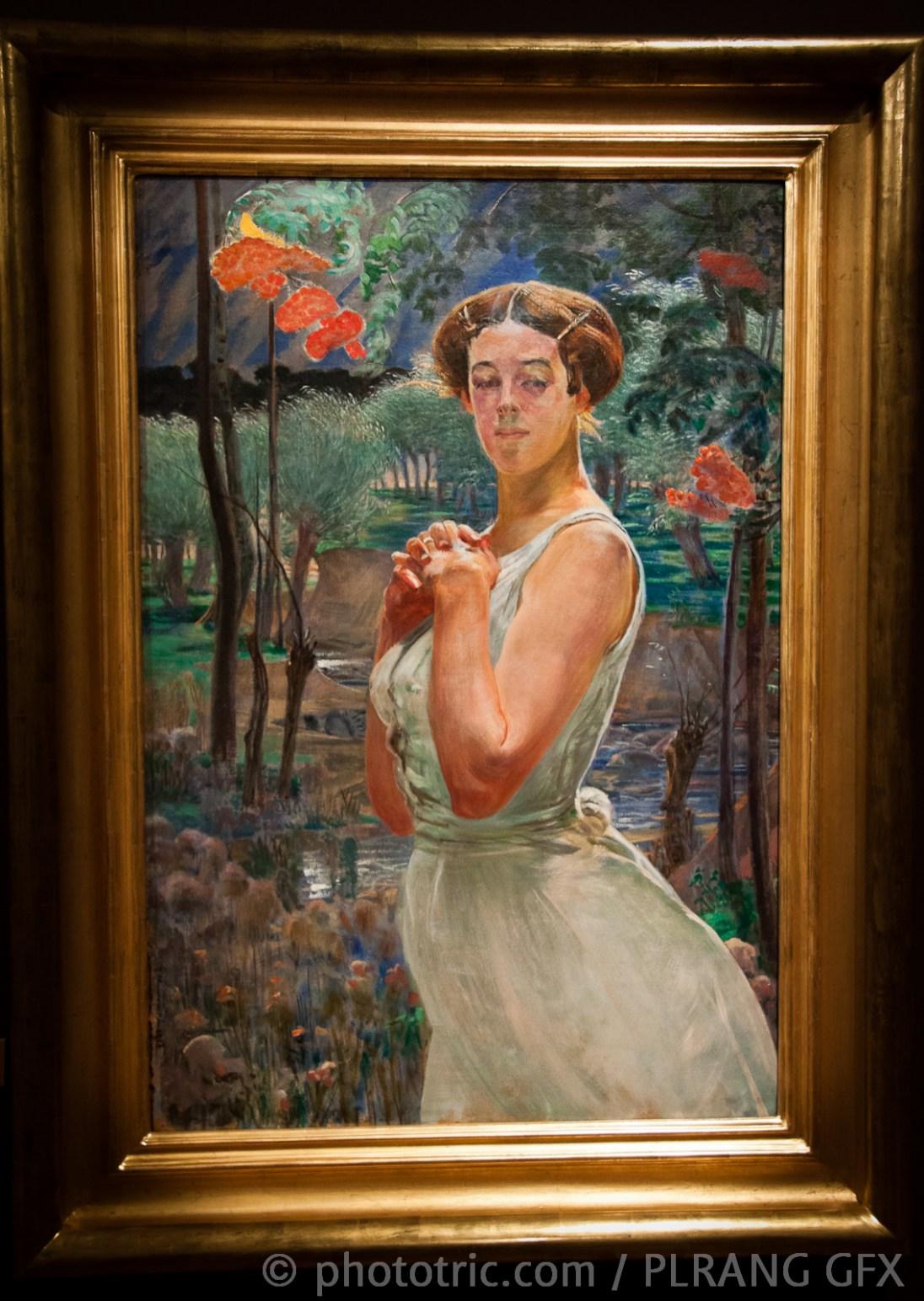 A woman in a grove