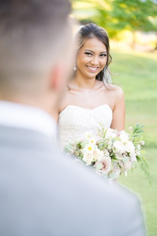A bride looks at her groom during their wedding at Westfields Golf Club in Clifton, Virginia.
