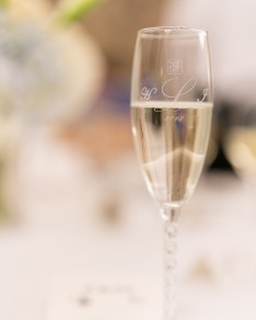 A champagne flute given as a wedding favor.