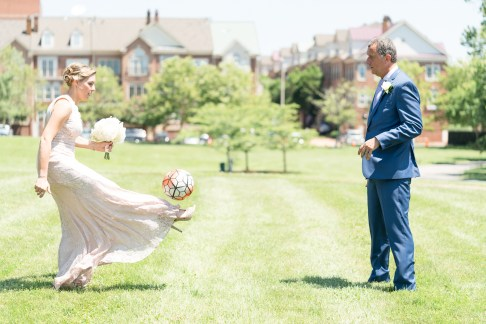 A bride and groom play soccer in Old Town Alexandria.