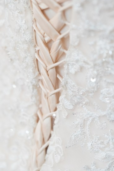 Detail shot of a bride's lace-up dress.