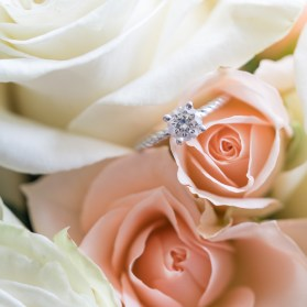 Wedding details including flowers and an engagement ring. Wedding photography by Erin Julius of Imagery by Erin.