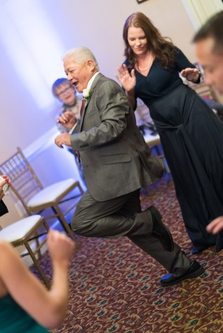The father of the bride dances during a wedding reception at Heritage Hunt Country Club in Gainesville, Virginia.