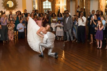 A bride kisses her husband during their first dance.